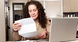 woman looking at medical bills