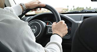man driving a car during the most dangerous month to drive