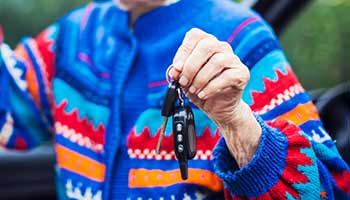 Elderly Driver handing over car keys